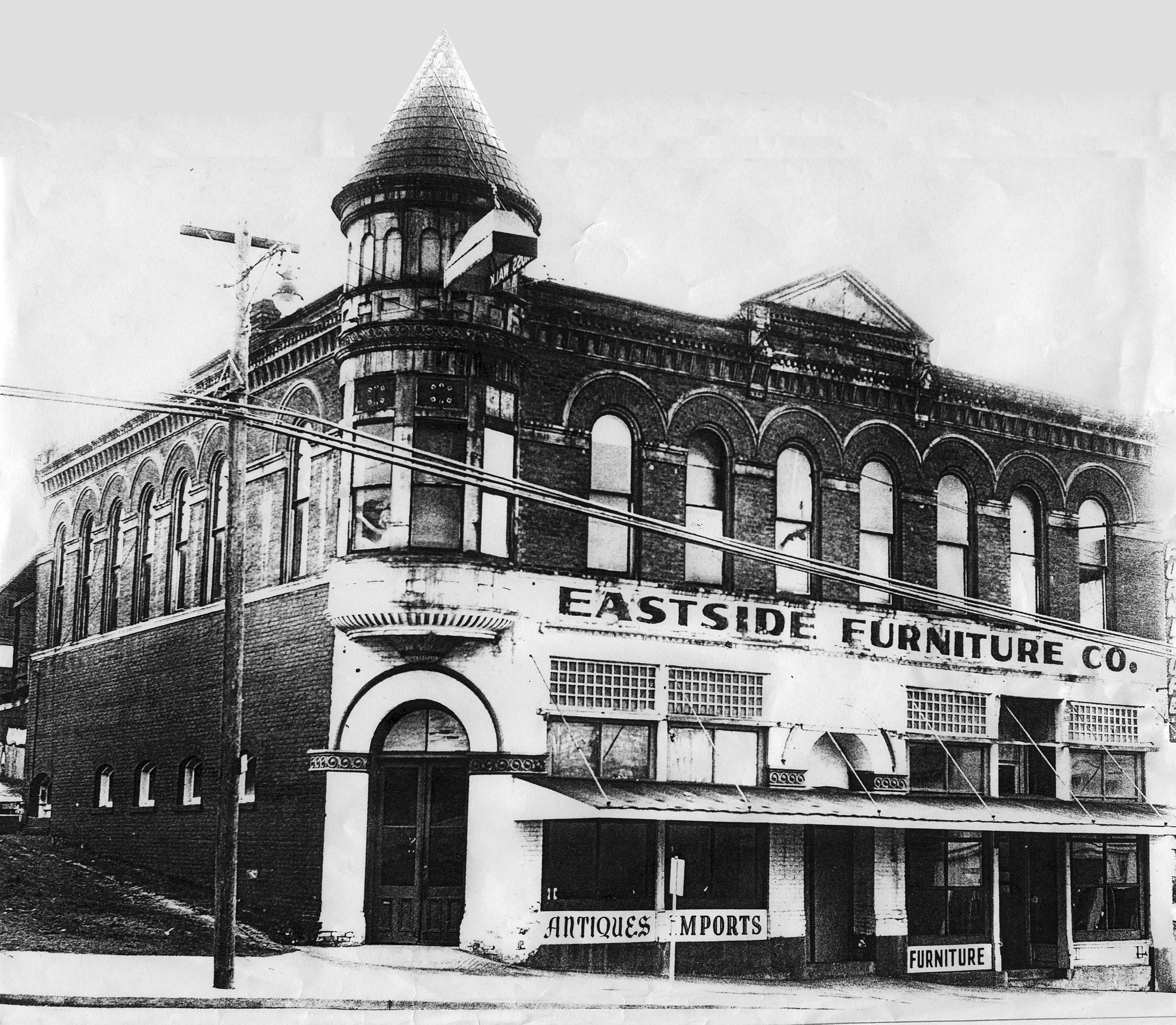Historic Peter Kirk Building with Eastside Furniture Company sign