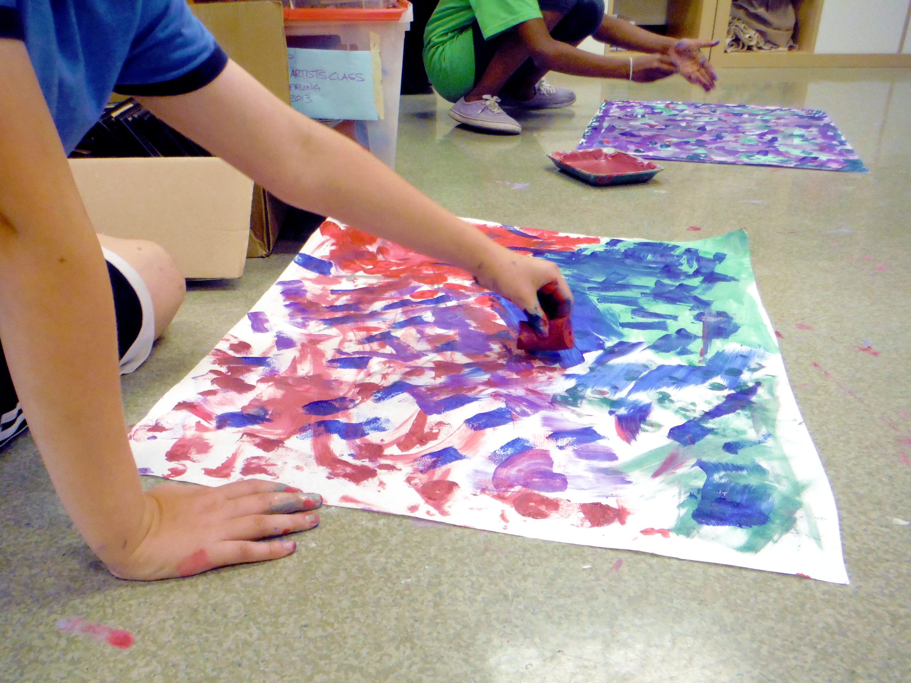 Children painting in youth summer art camp